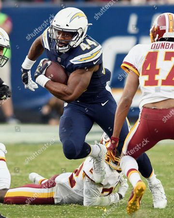 Los Angeles Chargers running back Andre Williams (44) gains yards on a run against the Washington Redskins in the fourth quarter of a game played at the StubHub Center in Carson, CA on