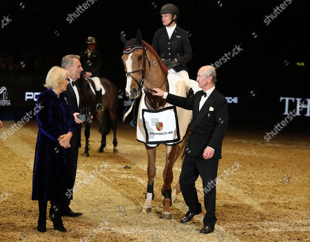 Camilla Duchess of Cornwall presents a trophy to Great Britain's Laura Renwick who won the Cayenne Puissance riding Top Dollar VI
