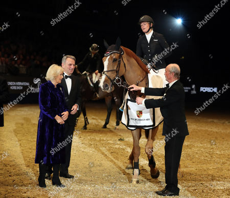 Camilla Duchess of Cornwall presents a trophy to Great Britain's Laura Renwick who won the Cayenne Puissance riding Top Dollar