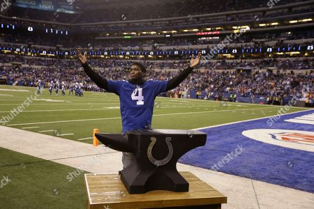 Indiana Pacers guard Victor Oladipo wears a Indianapolis Colts' Adam Vinatieri (4) jersey before an NFL football game against the Denver Broncos in Indianapolis