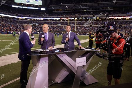 Liam McHugh, from left, Tony Dungy and Rodney Harrison talk on set during an NFL football game between the Indianapolis Colts and Denver Broncos in Indianapolis
