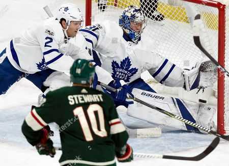 Chris Stewart, Ron Hainsey, Frederik Andersen. Minnesota Wild left wing Tyler Ennis, not pictured, scores a goal past Toronto Maple Leafs defenseman Ron Hainsey (2) and goalie Frederik Andersen (31), of Denmark, as Minnesota Wild right wing Chris Stewart (10) watches during the first period of an NHL hockey game, in St. Paul, Minn