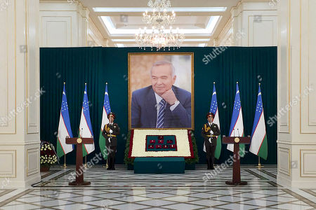 In this photo released by Kyrgyz Government Press Service, Uzbekistan honor guards stand next to a large portrait of the late President Islam Karimov and his awards in Samarkand, Uzbekistan, early . Karimov, whose harsh and ill-tempered rule governed Uzbekistan for a quarter-century, is to be buried in his home city of Samarkand