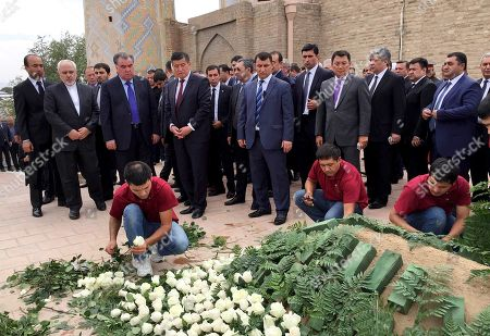 Javad Zarif, Emomali Rakhmon, Sooronbay Jeenbekov. From left front, Iran's Foreign Minister Mohammad Javad Zarif, Tajikistan's President Emomali Rakhmon, Kyrgyzstan's Prime Minister Sooronbay Jeenbekov stand at the grave of Uzbekistan's President Islam Karimov during his funeral ceremony in Samarkand, Uzbekistan, . Karimov, who crushed all opposition in the Central Asian country of Uzbekistan as its only president in a quarter-century of independence from the Soviet Union, has died of a stroke at age 78, the Uzbek government announced Friday