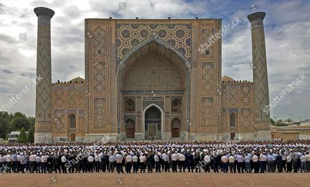 Uzbek men gather to pay their last respects, during the funeral of President Islam Karimov at the historic Registan Square in Samarkand, Uzbekistan, . Karimov, who crushed all opposition in the Central Asian country of Uzbekistan as its only president in a quarter-century of independence from the Soviet Union, has died of a stroke at age 78, the Uzbek government announced Friday