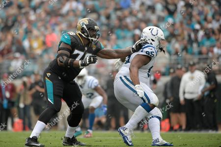 Jermey Parnell, Johnathan Hankins. Jacksonville Jaguars offensive tackle Jermey Parnell (78) blocks against Indianapolis Colts defensive end Johnathan Hankins (95) during the second half of an NFL football game, in Jacksonville, Fla. The Jaguars won 30-10