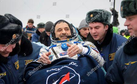 International Space Station (ISS) crew member Mikhail Kornienko of Russia is carried into a medical tent after landing near the town of Dzhezkazgan, Kazakhstan, . U.S. astronaut Scott Kelly and Kornienko returned to Earth on Wednesday after spending almost a year in space in a ground-breaking experiment foreshadowing a potential manned mission to Mars