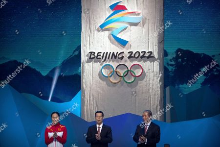 Zhang Hong, Zhang Gaoli, Yu Zaiqing. From left, 2014 Olympic speed skating gold medalist Zhang Hong of China, Chinese Vice Premier Zhang Gaoli, and Vice Chairman of the Chinese Olympic Committee Yu Zaiqing applaud as the emblem for the 2022 Beijing Winter Olympic Games is unveiled at a ceremony at the National Aquatics Center, also known as the Water Cube, in Beijing