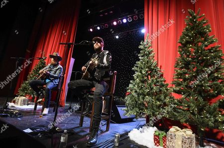 John Osborne, TJ Osborne. Musician John Osborne, left, and musician TJ Osborne, right, of the duo Brothers Osborne perform at a private concert and dinner hosted by Verizon Telematics for truck drivers on at Whiskey Pete's Showroom in Primm, Nev