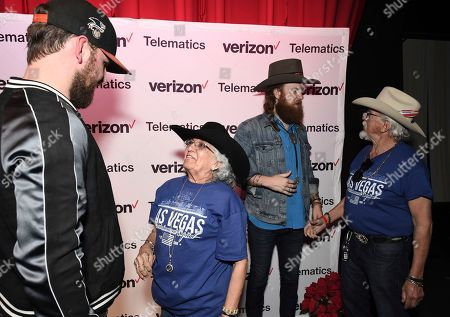 John Osborne, TJ Osborne. Musician John Osborne, left, and musician TJ Osborne of the duo Brothers Osborne backstage meeting with attendees at a private concert and dinner hosted by Verizon Telematics for truck drivers on at Whiskey Pete's Showroom in Primm, Nev