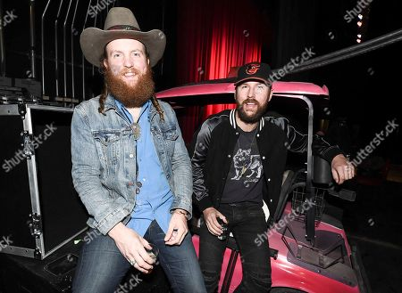 John Osborne, TJ Osborne. Musician John Osborne, left, and musician TJ Osborne of the duo Brothers Osborne backstage at a private concert and dinner hosted by Verizon Telematics for truck drivers on at Whiskey Pete's Showroom in Primm, Nev
