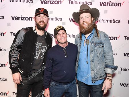 John Osborne, TJ Osborne. Musician John Osborne, left, and musician TJ Osborne of the duo Brothers Osborne backstage posing with a truck driver at a private concert and dinner hosted by Verizon Telematics on at Whiskey Pete's Showroom in Primm, Nev
