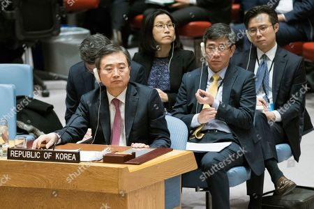 Stock Photo of South Korean Vice Minister of Foreign Affairs Cho Hyun listens as Chinese Ambassador to the United Nations Liu Jieyi speaks during a high level Security Council meeting on North Korea, at United Nations headquarters