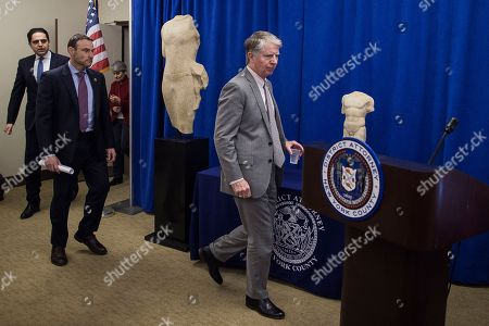 "Ancient sculptures, ""Calf Bearer,"" left, and the ""Torso,"" right, are displayed as Manhattan District Attorney Cyrus R. Vance, right, enters the room followed by Homeland Security Investigator, Erik Rosenblatt, Consul General of Lebanon in New York Majdi Ramadan and Irina Bokova during a press conference and repatriation ceremony at Manhattan District Attorney's Office in New York, . Three ancient sculptures are being returned to their rightful owners in Lebanon as the Manhattan district attorney forms a new antiquities trafficking unit. They were stolen from a temple during the Lebanese civil war that started in 1975"