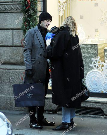 Matteo Ceccarini and Eva Riccobono with son Leo