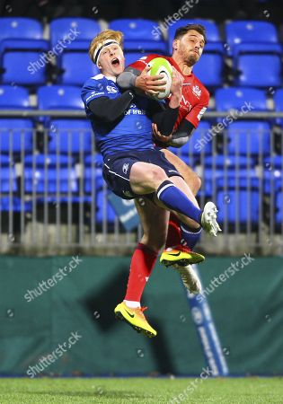 Jack Wallace of Bristol United and Tommy O?Brien of Leinster compete for aerial possession