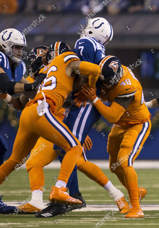 Stock Picture of Indianapolis Colts quarterback Jacoby Brissett (7) gets sacked by Denver linebacker Shane Ray (56) and Denver linebacker Shaquil Barrett (48) during NFL football game action between the Denver Broncos and the Indianapolis Colts at Lucas Oil Stadium in Indianapolis, Indiana. Denver defeated Indianapolis 25-13
