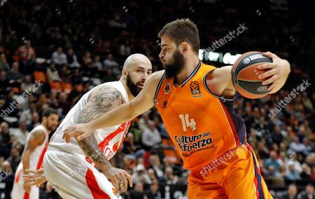 Stock Image of Valencia Basket´s Montenegrian center Bojan Dubljevic (R) in action against Red Star´s Macedonian center Pero Antic (L) during the EuroLeague basketball match between Valencia Basket and Res Star Belgrade played at Fuente de San Luis pavilion in Valencia, estaern Spain, 15 December 2017.