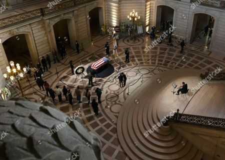 Mourners visit the casket containing the body of Mayor Ed Lee lying in repose in the San Francisco City Hall rotunda, in San Francisco. Lee died Tuesday. He was San Francisco's first Asian-American mayor and presided over the city as it climbed out of a recession and into a boomtown driven by tech