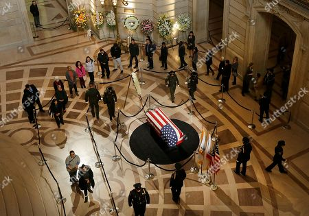 Mourners wait to walk past the casket containing the body of Mayor Ed Lee lying in repose in the San Francisco City Hall rotunda,, in San Francisco. Lee died early Tuesday after collapsing at a grocery store, leaving the city reeling from shock and dealing with the logistics of selecting a new leader