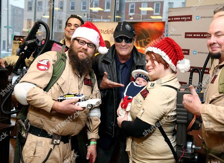 Dan Aykroyd and fans in Ghostbuster outfits