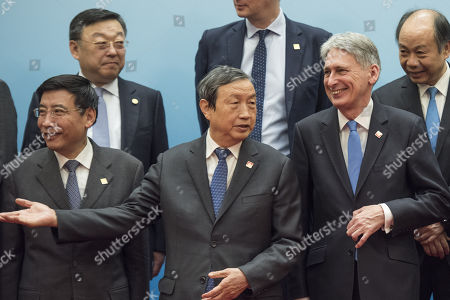 Stock Photo of Britain's Chancellor of the Exchequer Philip Hammond (2-R) and Chinese Vice Premier Ma Kai (C) pose with delegates during the UK-China Economic Financial Dialogue at the Diaoyutai State Guesthouse in Beijing, China, 16 December 2017.