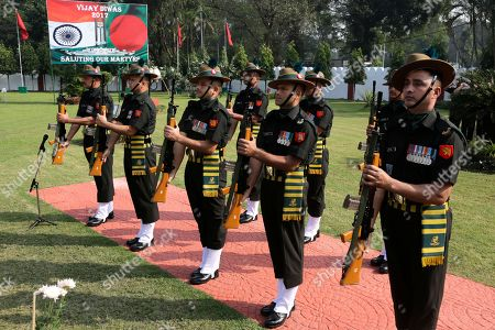 Army soldiers pay tribute to martyrs during a ceremony on the occasion of Vijay Divas or Victory Day at Fort Williams, in Kolkata, India, . Vijay Divas is celebrated to mark India's victory over Pakistan in the 1971 war to liberate Bangladesh