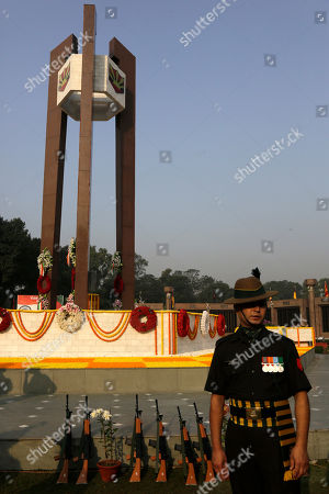 An army soldier stands beside the Martyrs' Column to pay tribute to martyrs during a ceremony on the occasion of Vijay Divas or Victory Day at Fort Williams, in Kolkata, India, . Vijay Divas is celebrated to mark India's victory over Pakistan in the 1971 war to liberate Bangladesh