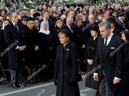 Princess Margaret of Hohenzollern, daughter of former Romanian King Michael, center, and her husband Prince Radu of Romania, right, attend the funeral ceremony outside the former royal palace in Bucharest, Romania, Saturday, Dec.16, 2017. Thousands waited in line to pay their respects to Former King Michael, who ruled Romania during WWII, and died, aged 96, in Switzerland
