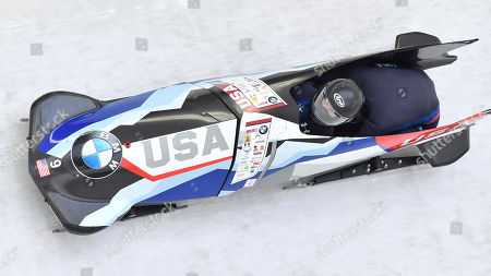 Brittany Reinbolt and Aja Evans of the USA speeds down the track during their first run of the women's bobsled World Cup race in Innsbruck