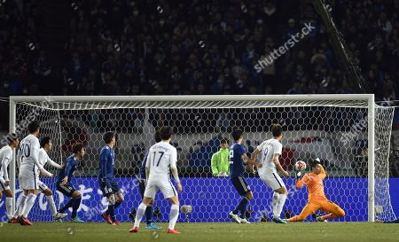 Japan's goalkeeper Kosuke Nakamura (R) fails to catch the ball to concede a goal by South Korea's midfielder Yeom Kihun (unseen) during the East Asian Football Federation (EAFF) E-1 Football championship 2017 men's match between Japan and South Korea in Tokyo, Japan, 16 December 2017. South Korea defeated Japan to win the championship.