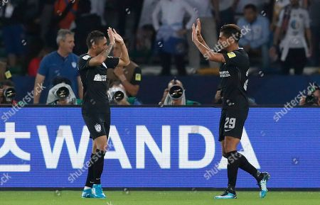 Pachuca's Franco Jara, right, celebrates with Jonathan Urretaviscaya after scoring his side's second goal during the Club World Cup third place soccer match between Al Jazira and CF Pachuca at Zayed Sports City stadium in Abu Dhabi, United Arab Emirates