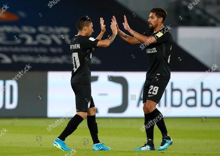 Pachuca's Jonathan Urretaviscaya celebrates with Franco Jara, right, after scoring the opening goal during the Club World Cup third place soccer match between Al Jazira and CF Pachuca at Zayed Sports City stadium in Abu Dhabi, United Arab Emirates