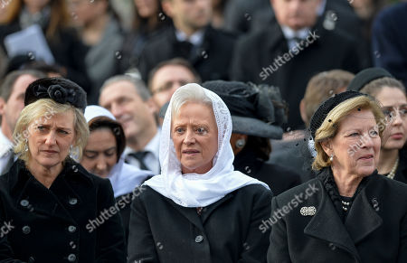 Belgium's Princess Astrid, left, stands next to Princess Muna al-Hussein of Jordan, center, and Greece's Queen Anne Marie, right, during the funeral ceremony in tribute to late Romanian King Michael in Bucharest, Romania, . Tens of thousands of Romanians joined the European royals on Saturday to pay their respects to late King Michael as a state funeral got underway. Michael, who ruled Romania twice before being forced to abdicate by the communists in 1947, died at the age of 96 in Switzerland this month