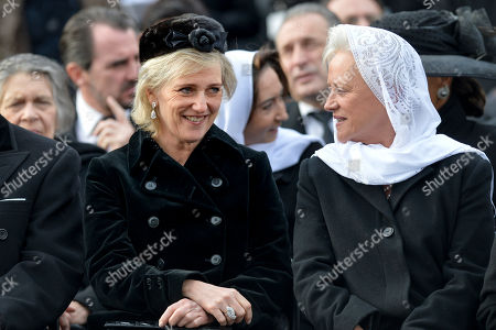 Belgium's Princess Astrid, left, talks to Princess Muna al-Hussein of Jordan while attending the funeral ceremony in tribute to late Romanian King Michael in Bucharest, Romania, . Tens of thousands of Romanians joined the European royals on Saturday to pay their respects to late King Michael as a state funeral got underway. Michael, who ruled Romania twice before being forced to abdicate by the communists in 1947, died at the age of 96 in Switzerland this month
