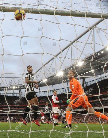 Mesut Ozil of Arsenal scores the opening goal past  Rob Elliot of Newcastle United