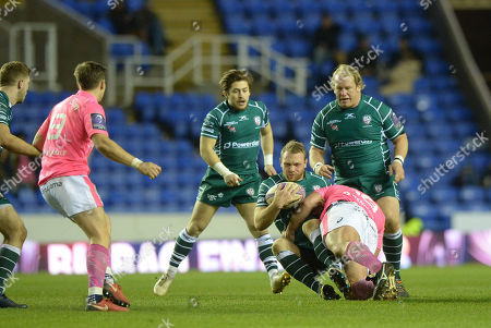 Greig Tonks of London Irish is brought down in the tackle by Giorgi Melikidze of Stade Francais Paris during the European Rugby Challenge Cup Pool 4 match between London Irish and Stade Francais Paris at Madejski Stadium on December 16th 2017 in Reading, Berkshire, England. (Photo by Gareth Davies/PPAUK)