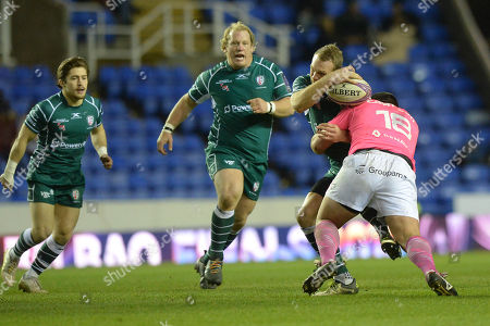 Greig Tonks of London Irish is held in the tackle by Giorgi Melikidze of Stade Francais Paris during the European Rugby Challenge Cup Pool 4 match between London Irish and Stade Francais Paris at Madejski Stadium on December 16th 2017 in Reading, Berkshire, England. (Photo by Gareth Davies/PPAUK)
