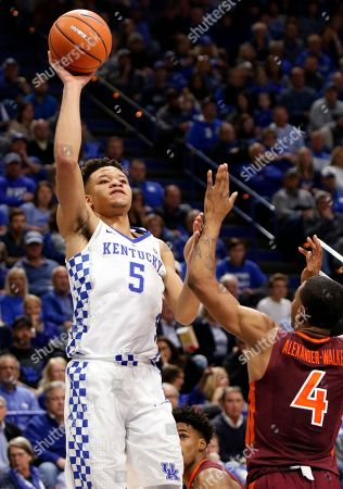 Stock Image of Kevin Knox, Nickeil Alexander-Walker. Kentucky's Kevin Knox (5) shoots while pressured by Virginia Tech's Nickeil Alexander-Walker (4) during the first half of an NCAA college basketball game, in Lexington, Ky