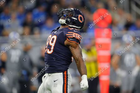 Chicago Bears linebacker Lamarr Houston reacts after a play during the first half of an NFL football game against the Detroit Lions, in Detroit