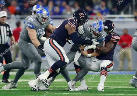 Roy Robertson-Harris, Lamarr Houston, Matthew Stafford. Detroit Lions quarterback Matthew Stafford (9) is sacked by Chicago Bears defensive end Roy Robertson-Harris, left, and linebacker Lamarr Houston during the first half of an NFL football game, in Detroit