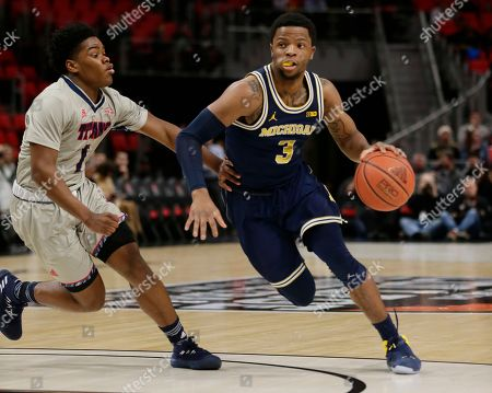 Zavier Simpson, Jermaine Jackson Jr. Michigan guard Zavier Simpson (3) drives against Detroit guard Jermaine Jackson Jr. (1) during the first half of an NCAA college basketball game, in Detroit