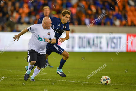 Astronaut Scott Kelly battles for a ball against Youtube sensation Kade Speiser during the Kick In for Houston celebrity charity soccer match at BBVA Compass Stadium in Houston, TX