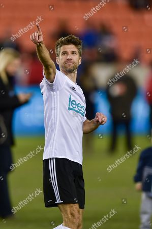 Stock Image of NBC Sports Soccer Analyst Kyle Martino celebrates making a penalty kick during the Kick In for Houston celebrity charity soccer match at BBVA Compass Stadium in Houston, TX