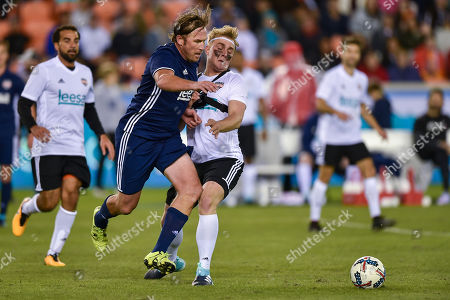 Bode Miller moves through Jake Paul for a ball during the Kick In for Houston celebrity charity soccer match at BBVA Compass Stadium in Houston, TX