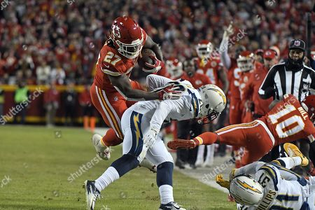 Kareem Hunt, Desmond King. Kansas City Chiefs running back Kareem Hunt (27) tries to get past Los Angeles Chargers defensive back Desmond King (20) during the first half of an NFL football game in Kansas City, Mo