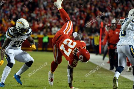 Kareem Hunt, Desmond King, Rayshawn Jenkins. Kansas City Chiefs running back Kareem Hunt (27) is upended after a tackle by Los Angeles Chargers defensive back Desmond King, right, as safety Rayshawn Jenkins (25) follows, during the first half of an NFL football game in Kansas City, Mo