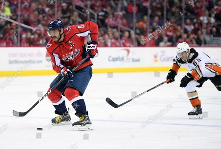Alex Ovechkin, Kevin Roy. Washington Capitals left wing Alex Ovechkin (8), of Russia, skates with the puck past Anaheim Ducks left wing Kevin Roy (63) during the second period of an NHL hockey game, in Washington