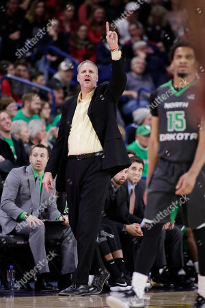 North Dakota head coach Brian Jones directs his team during the first half of an NCAA college basketball game against Gonzaga in Spokane, Wash