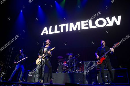 Stock Picture of Jack Barakat, Alex Gaskarth, Zack Merrick, Rian Dawson. Jack Barakat, from left, Alex Gaskarth, Zack Merrick and Rian Dawson of All Time Low perform at 93.3 FLZ's Jingle Ball at Amalie Arena, in Tampa, Fla